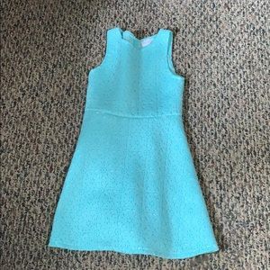A turquoise dress